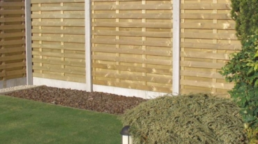 Photo d'une palissade bois Extra Lourd avec soubassements béton